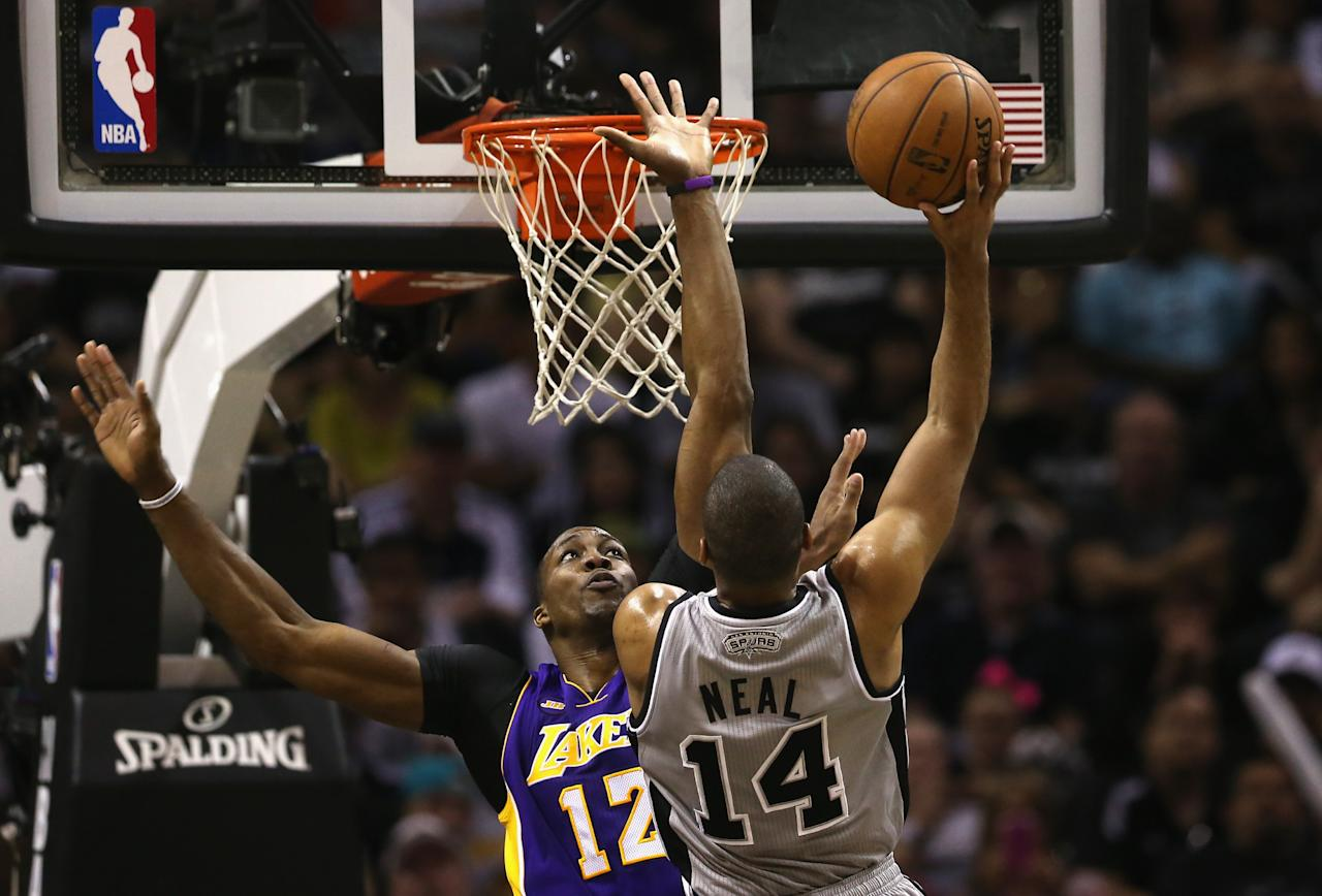 SAN ANTONIO, TX - APRIL 21:  Dwight Howard #12 of the Los Angeles Lakers defends the shot by Gary Neal #14 of the San Antonio Spurs during Game One of the Western Conference Quarterfinals of the 2013 NBA Playoffs at  at AT&T Center on April 21, 2013 in San Antonio, Texas. NOTE TO USER: User expressly acknowledges and agrees that, by downloading and or using this photograph, User is consenting to the terms and conditions of the Getty Images License Agreement.  (Photo by Ronald Martinez/Getty Images)