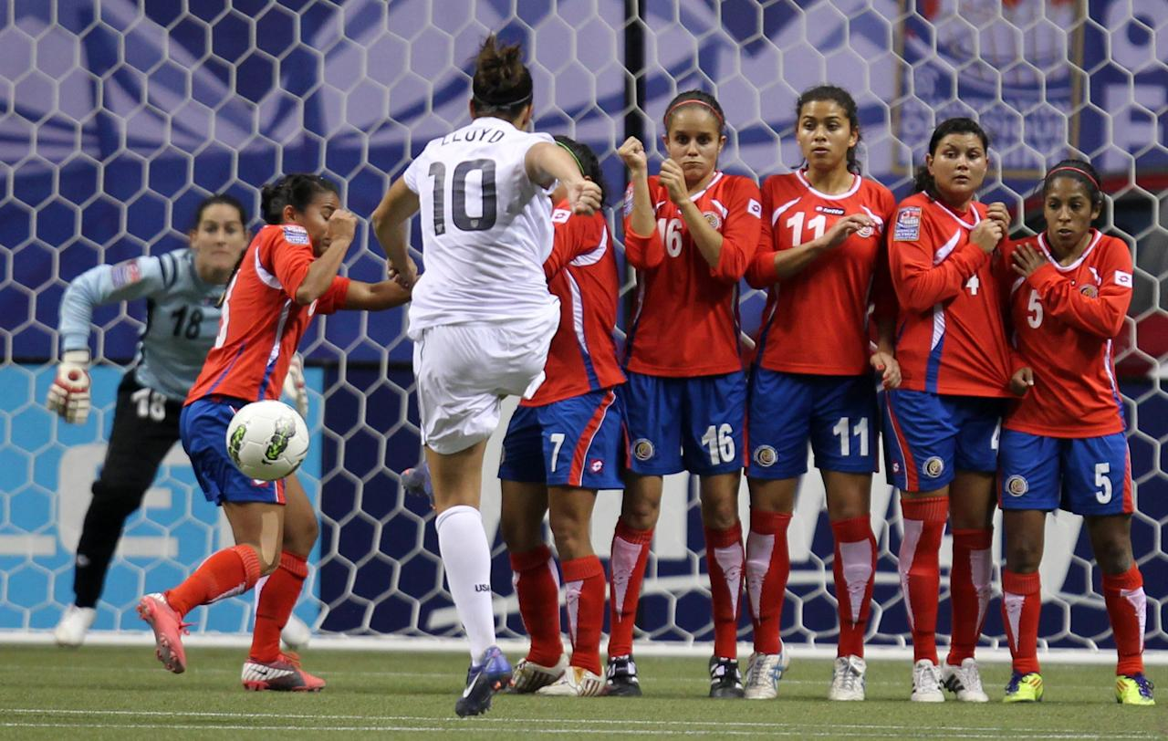 United States' Carli Lloyd (10) takes a free kick against Costa Rica during the second half of CONCACAF women's Olympic qualifying soccer game action at B.C. Place in Vancouver, British Columbia, Friday, Jan. 27, 2012. (AP Photo/The Canadian Press, Jonathan Hayward)