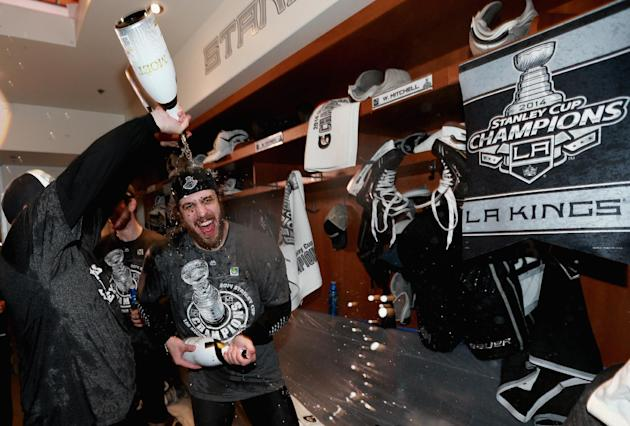 Los Angeles Kings center Anze Kopitar, of Slovenia, celebrates in the locker room after his team won the Stanley Cup in double overtime over the New York Rangers in Game 5 of the 2014 Stanley Cup Final series Friday, June 13, 2014, in Los Angeles, California. The Kings won the game 3-2. (AP Photo/ Dave Sandford, NHLI via Getty Images, pool)