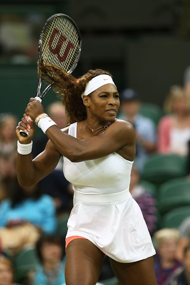 LONDON, ENGLAND - JUNE 29: Serena Williams of the United States of America plays a backhand during the Ladies' Singles third round match against Kimiko Date-Krumm of Japan on day six of the Wimbledon Lawn Tennis Championships at the All England Lawn Tennis and Croquet Club on June 29, 2013 in London, England. (Photo by Clive Brunskill/Getty Images)