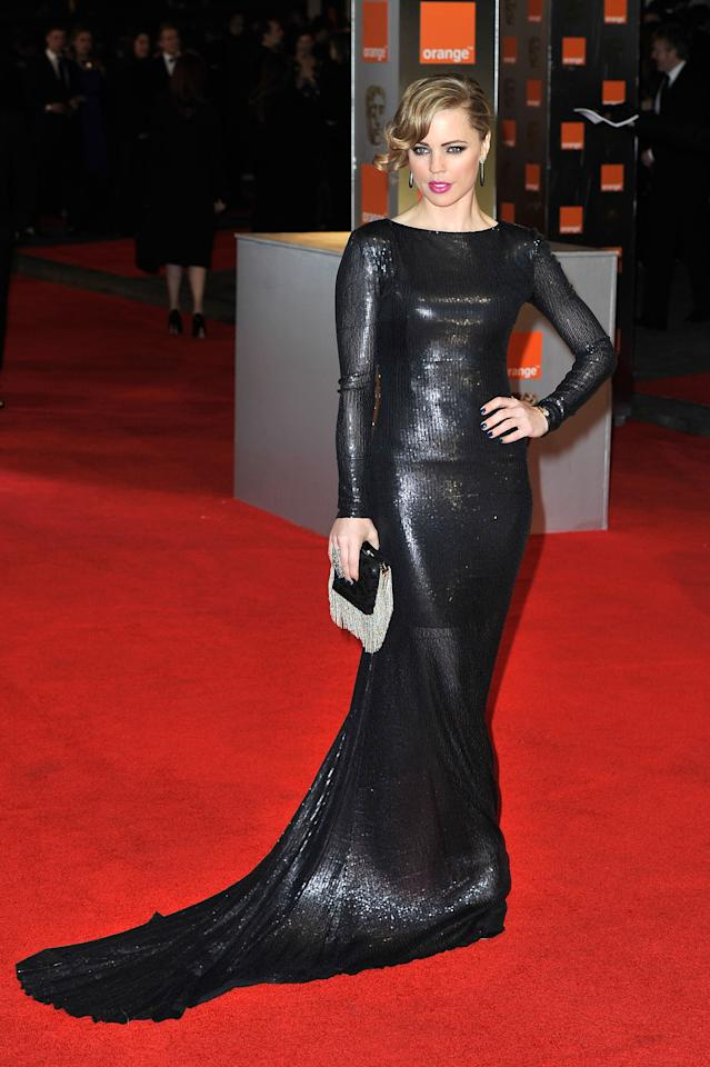 LONDON, ENGLAND - FEBRUARY 12:  Actress Melissa George attends the Orange British Academy Film Awards 2012 at the Royal Opera House on February 12, 2012 in London, England.  (Photo by Gareth Cattermole/Getty Images)