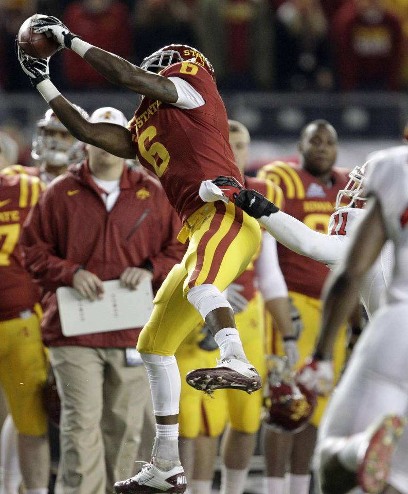 Iowa State wide receiver Tad Ecby (6) makes a catch on a pass from Steele Jantz in the third quarter of the Pinstripe Bowl NCAA college football game against Rutgers, Friday, Dec. 30, 2011, at Yankee Stadium in New York. ( AP Photo/Julio Cortez)