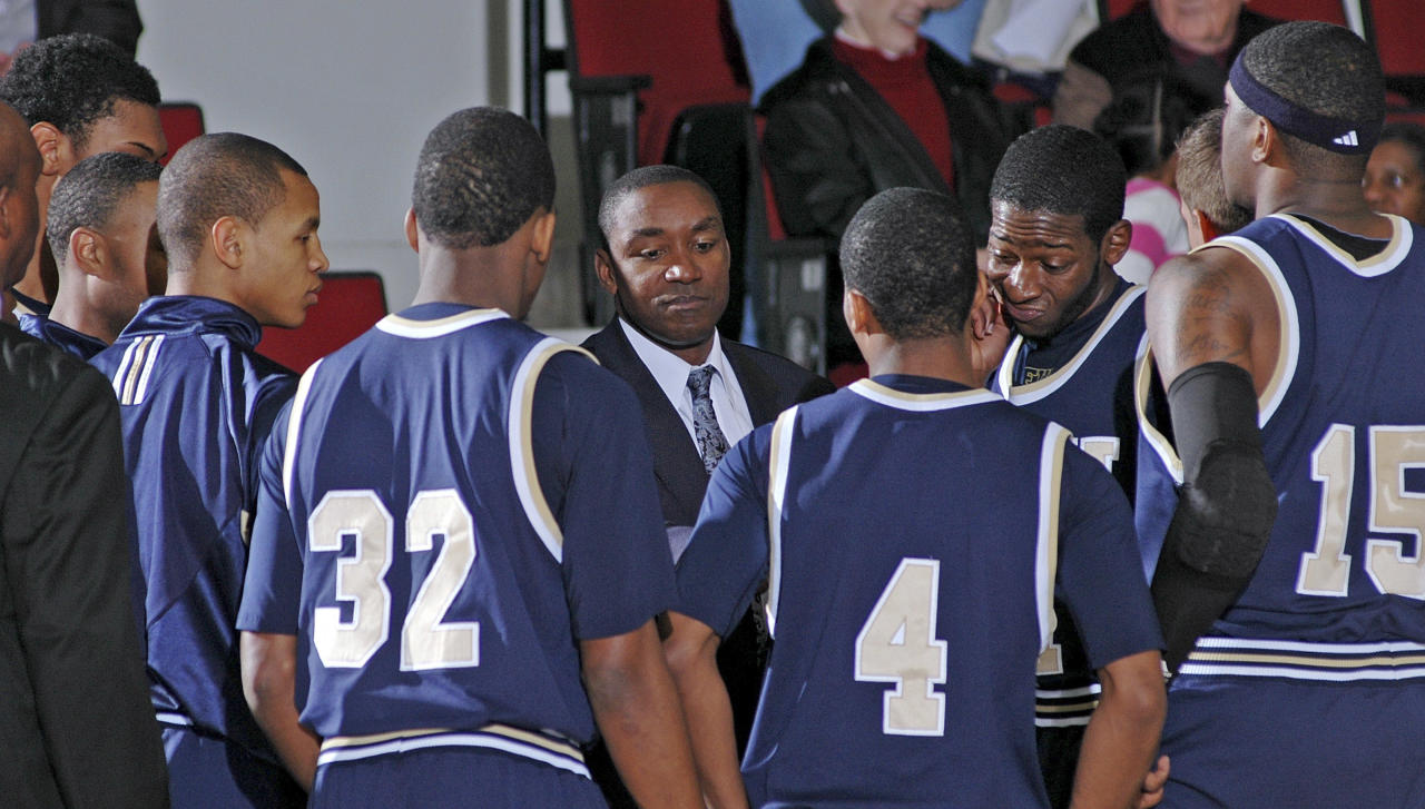 Florida International coach Isiah Thomas, center, talks to his players prior to an NCAA college basketball game against Troy in Troy, Ala., Thursday, Feb. 3, 2011.