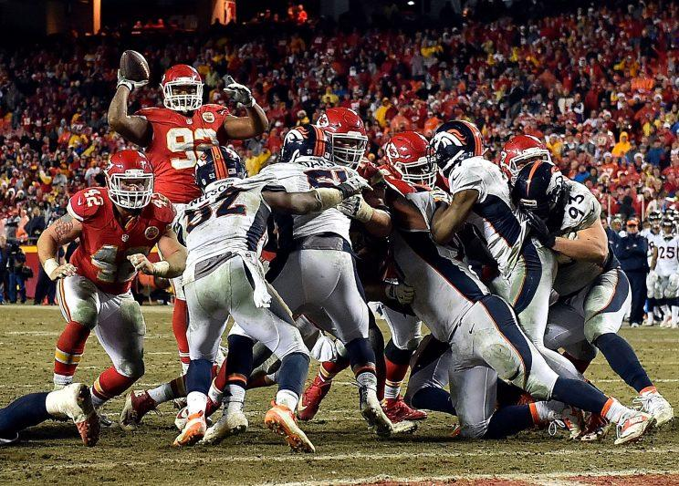 The Chiefs' Dontari Poe did a spot-on impression of Tim Tebow in Sunday's victory against the Broncos. (Getty Images)