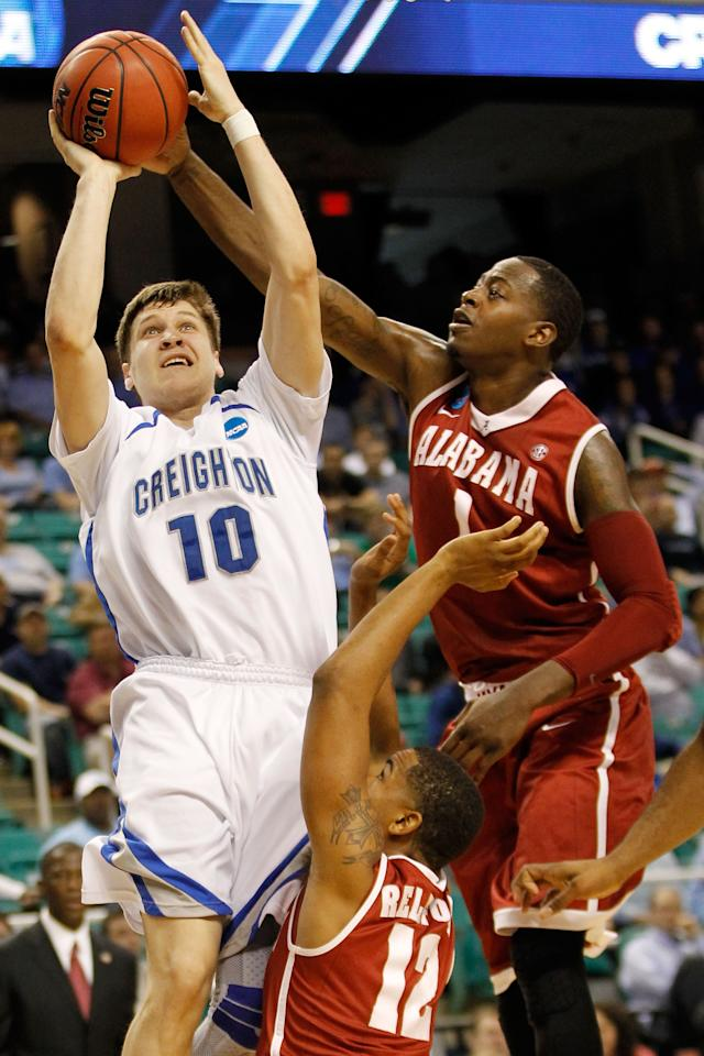 GREENSBORO, NC - MARCH 16:  Grant Gibbs #10 of the Creighton Bluejays drives to the hoop against JaMychal Green #1 and Trevor Releford #12 of the Alabama Crimson Tide during the second round of the 2012 NCAA Men's Basketball Tournament at Greensboro Coliseum on March 16, 2012 in Greensboro, North Carolina.  (Photo by Streeter Lecka/Getty Images)