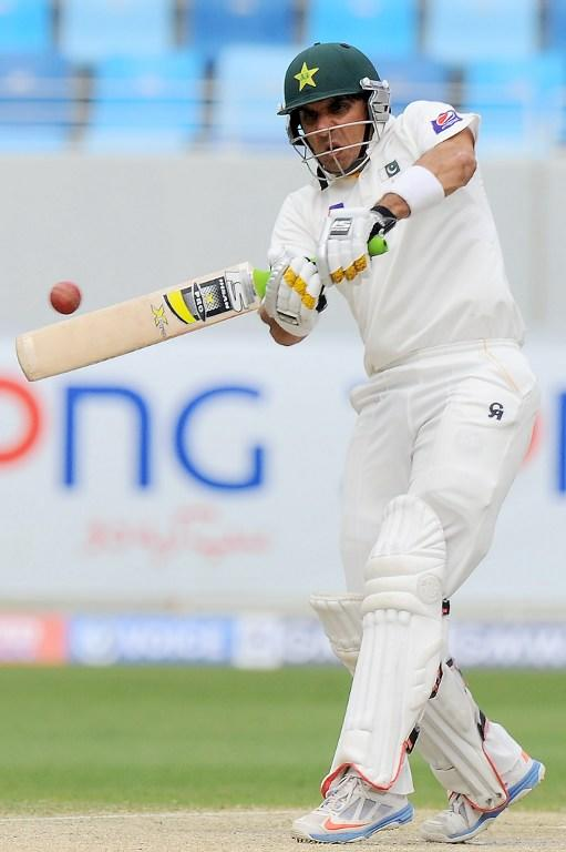 Pakistan batsman Misbah-ul-Haq plays a shot during the fourth day of the second cricket Test match between Pakistan and Sri Lanka at the Dubai International Cricket Stadium in Dubai on January 11, 2014.  AFP PHOTO/Ishara S. KODIKARA
