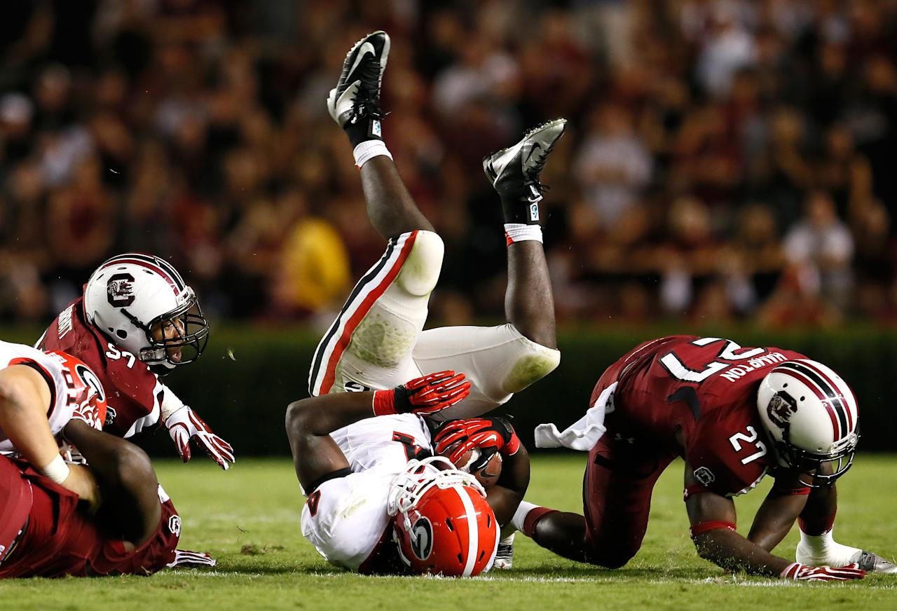 COLUMBIA, SC - OCTOBER 06:  Keith Marshall #4 of the Georgia Bulldogs is tackled by J.T. Surratt #97 and Victor Hampton #27 of the South Carolina Gamecocks at Williams-Brice Stadium on October 6, 2012 in Columbia, South Carolina.  (Photo by Kevin C. Cox/Getty Images)
