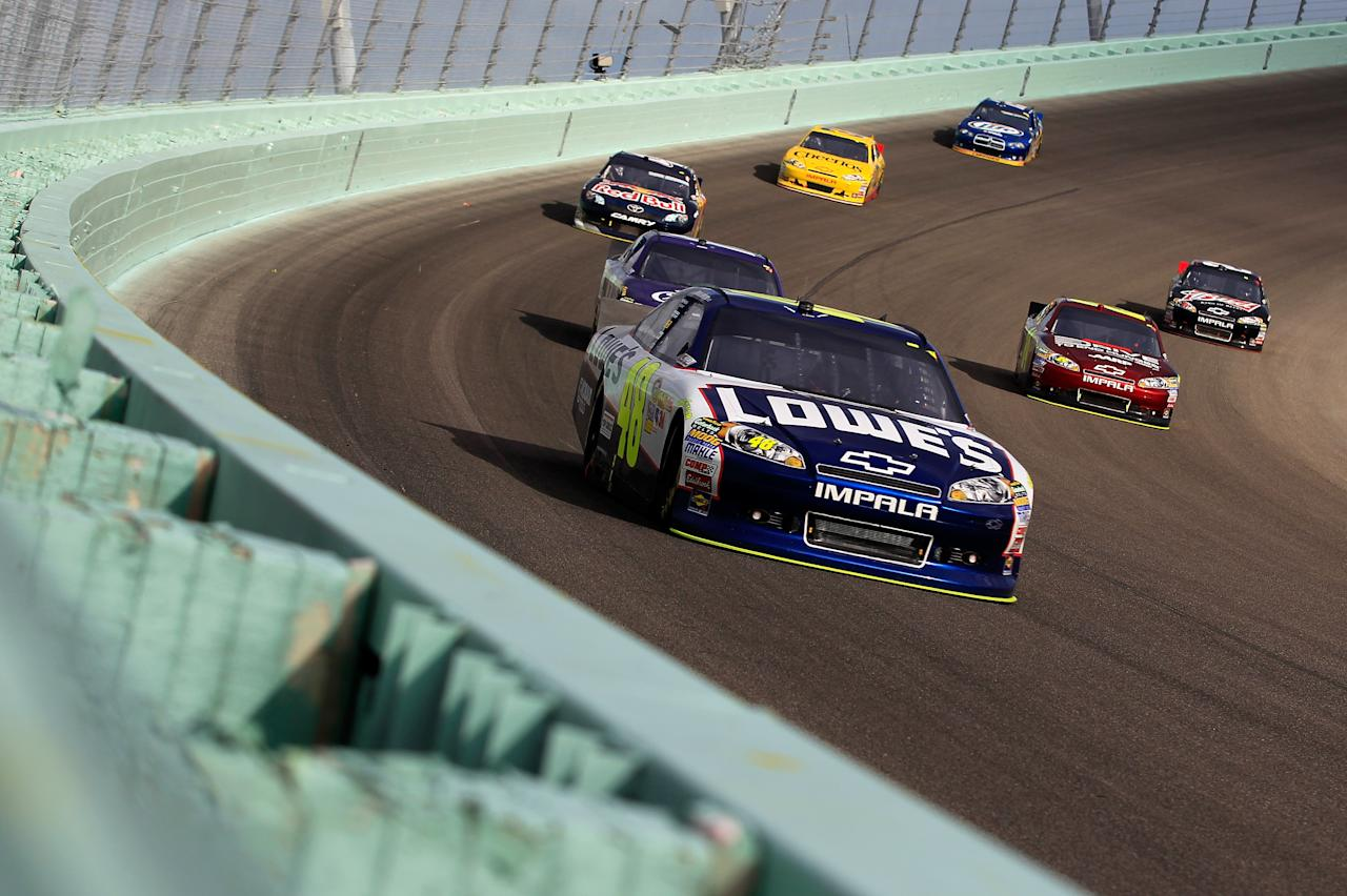 HOMESTEAD, FL - NOVEMBER 20:  Jimmie Johnson, driver of the #48 Lowe's Chevrolet, leads the field during the NASCAR Sprint Cup Series Ford 400 at Homestead-Miami Speedway on November 20, 2011 in Homestead, Florida.  (Photo by Chris Trotman/Getty Images for NASCAR)