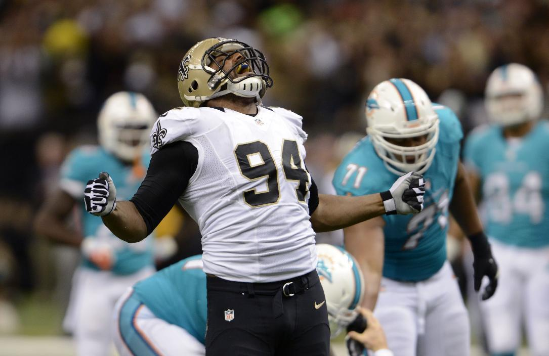 New Orleans Saints defensive end Cameron Jordan (94) celebrates a sack in the second half of an NFL football game against the Miami Dolphins in New Orleans, Monday, Sept. 30, 2013. (AP Photo/Bill Feig)