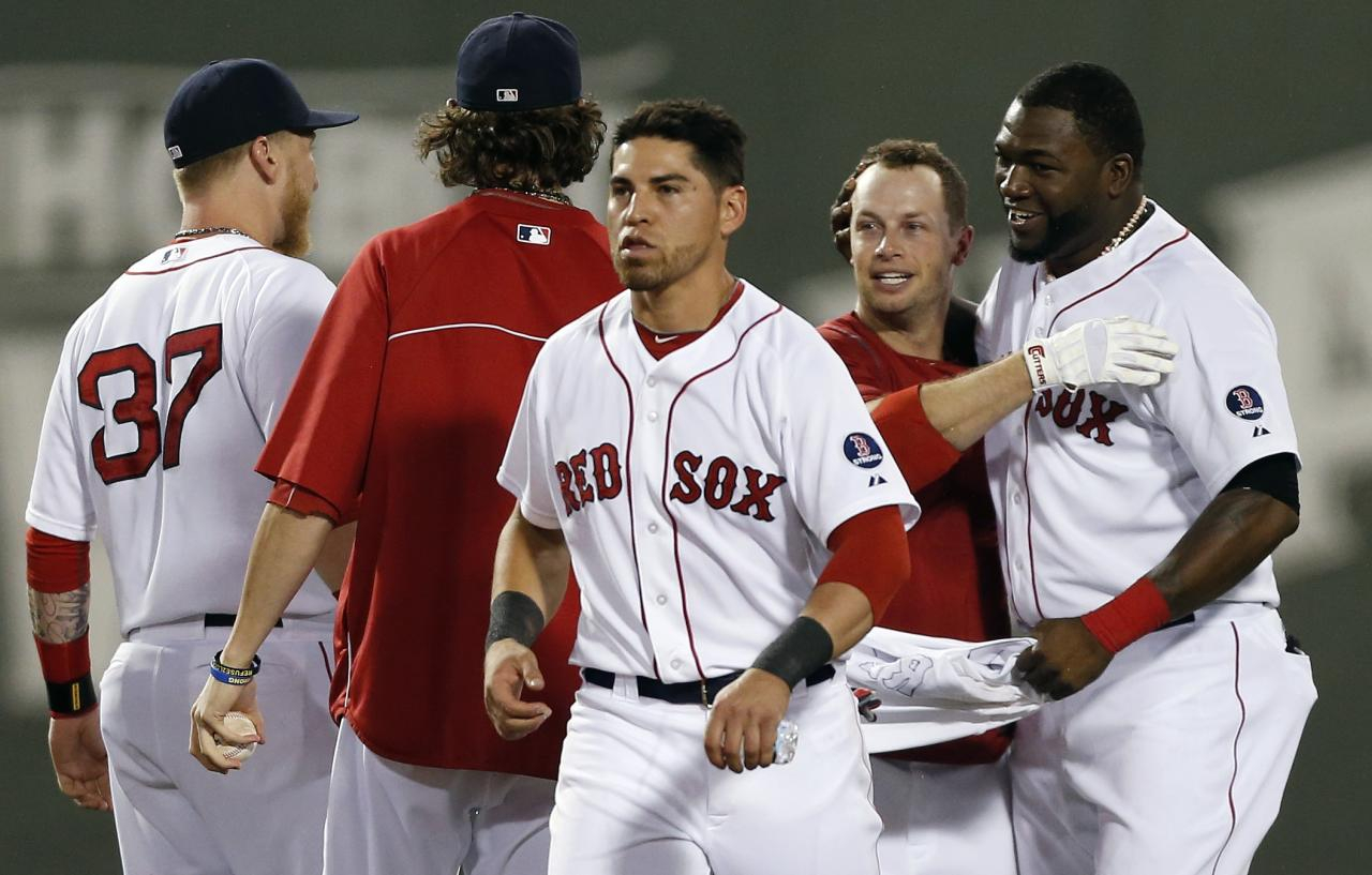 Boston Red Sox's Daniel Nava, second from right, celebrates his walkoff RBI-single with teammates, from left, Mike Carp (37), Clay Buchholz, Jacoby Ellsbury and David Ortiz in the ninth inning of a baseball game against the Seattle Mariners in Boston, Thursday, Aug. 1, 2013. The Red Sox won 8-7. (AP Photo/Michael Dwyer)