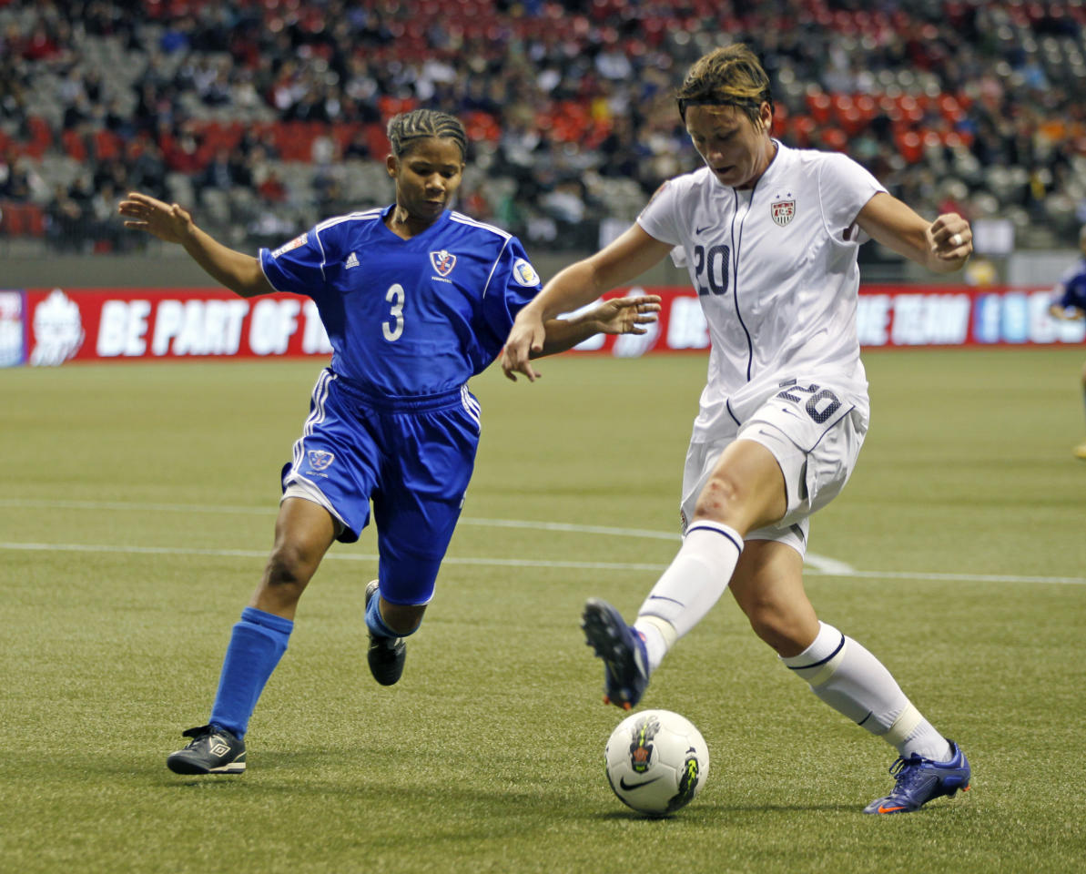 VANCOUVER, CANADA - JANUARY 20:  Mary Abigail Wambach #20 of the United States and Denny Vargas #3 of the Dominican Republic compete for the ball during their game at the 2012 CONCACAF Women's Olympic Qualifying Tournament at BC Place on January 20, 2012 in Vancouver, British Columbia, Canada.  (Photo by Jeff Vinnick/Getty Images)