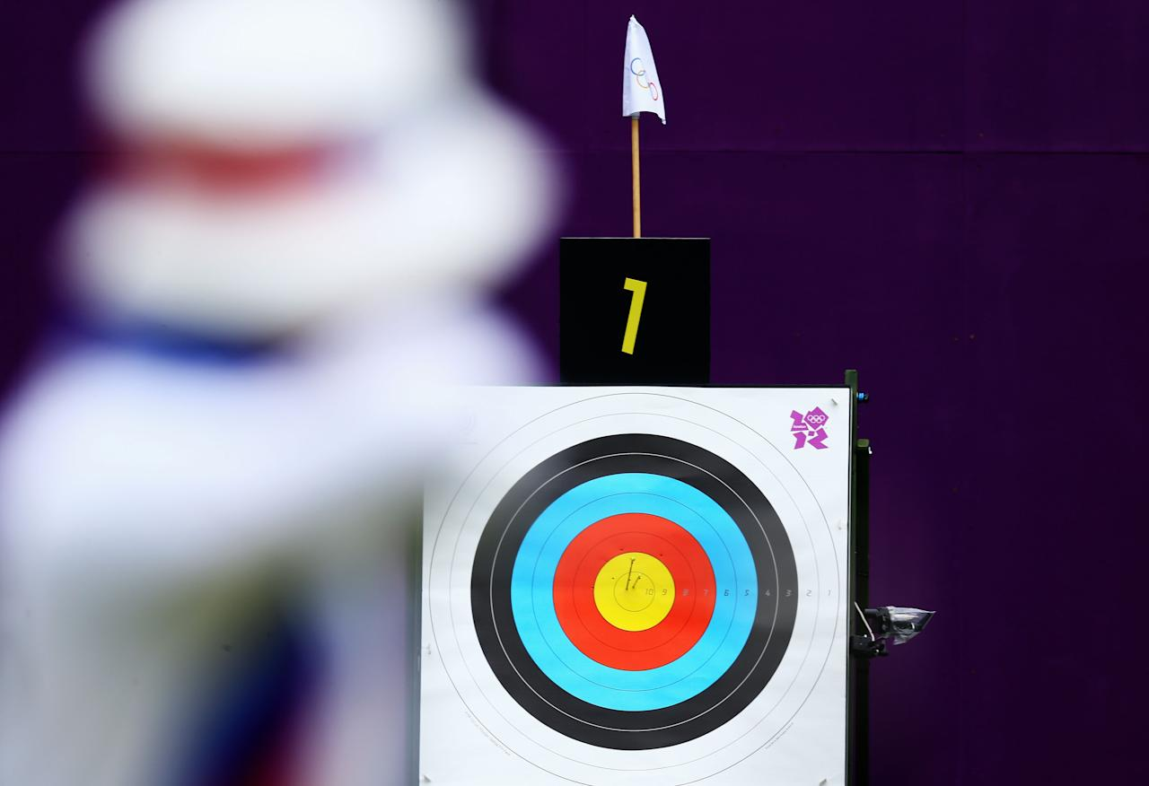 LONDON, ENGLAND - JULY 31:  Takaharu Furukawa of Japan competes in his Men's Individual Archery 1/32 Eliminations match against Kar Wai Calvin Lee of Hong Kong during Day 4 of the London 2012 Olympic Games at at Lord's Cricket Ground on July 31, 2012 in London, England.  (Photo by Paul Gilham/Getty Images)