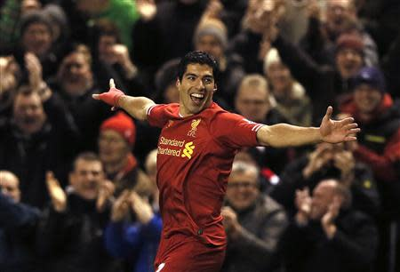 Liverpool's Suarez celebrates scoring a goal against Norwich during their English Premier League soccer match at Anfield in Liverpool