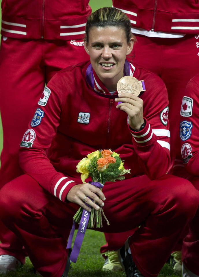 Canada women's soccer player Christine Sinclair shows off her Bronze medal at the Olympic Games in London on Thursday August 9, 2012. THE CANADIAN PRESS/Frank Gunn