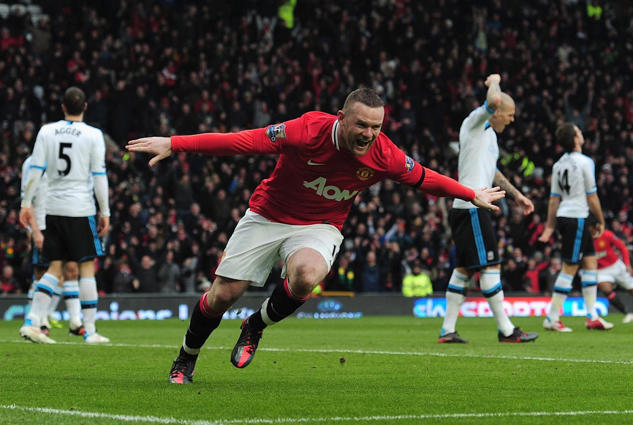 MANCHESTER, ENGLAND - FEBRUARY 11: Wayne Rooney of Manchester United scores the opening goal during the Barclays Premier League match between Manchester United and Liverpool at Old Trafford on February 11, 2012 in Manchester, England.  (Photo by Shaun Botterill/Getty Images)