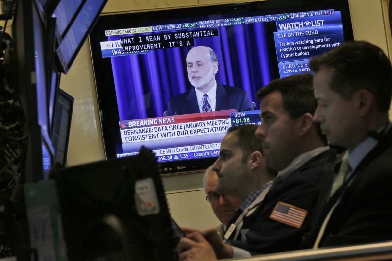 Stocks rise as Federal Reserve stands by stimulus