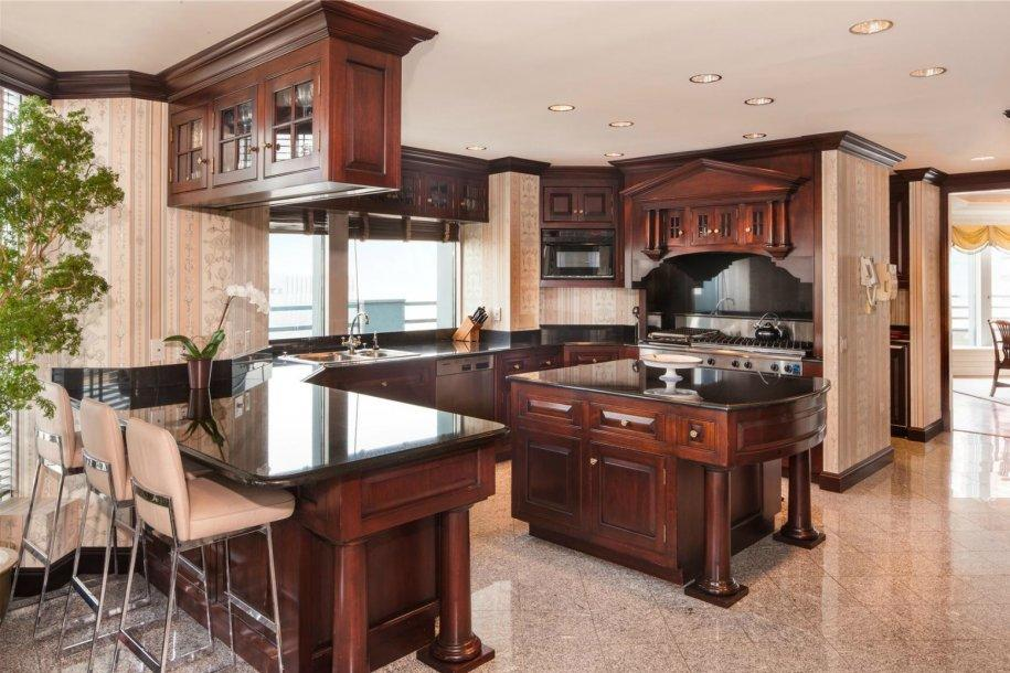 The home has an eat-in chef's kitchen with adjacent butler's pantry.