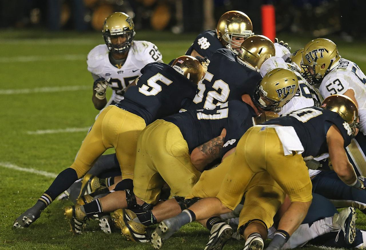 SOUTH BEND, IN - NOVEMBER 03: Everett Golson  #5 of the Notre Dame Fighting Irish follows blockers into the end zone to score the game-winning touchdown against the Pittsburgh Panthers at Notre Dame Stadium on November 3, 2012 in South Bend, Indiana. Notre Dame defeated Pittsburgh 29-26 in triple overtime. (Photo by Jonathan Daniel/Getty Images)