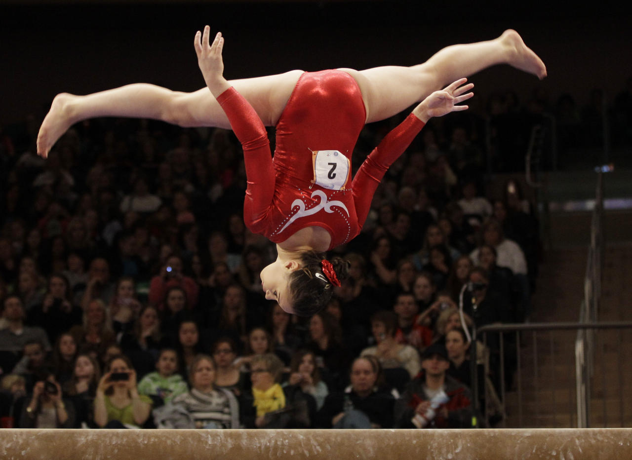 Victoria Moors of Canada flips on the balance beam during the American Cup gymnastics meet at Madison Square Garden in New York, Saturday, March 3, 2012.  Moors placed fourth in the event. (AP Photo/Kathy Willens)