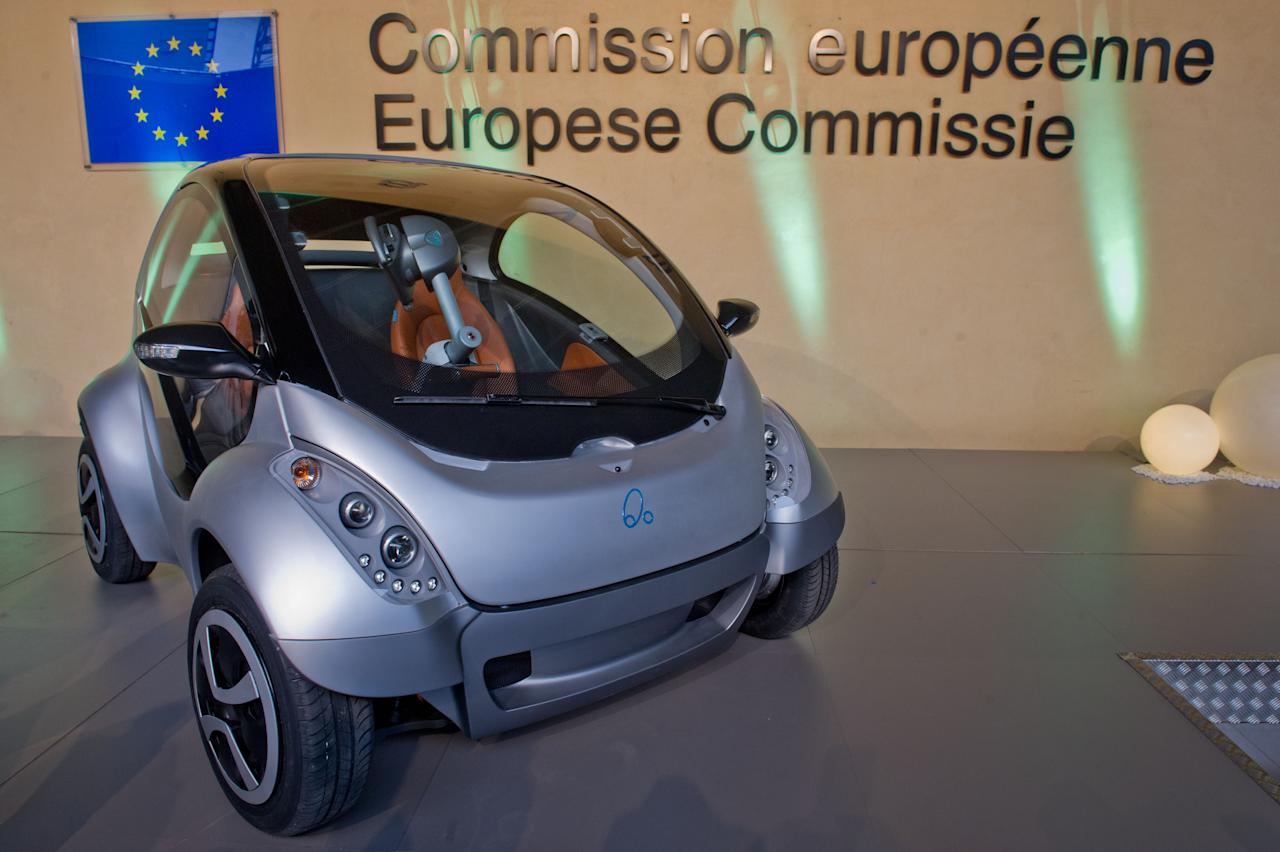 "BRUSSELS, BELGIUM - JANUARY 24:  The first prototype of the HIRIKO electric car, during the global launch of Hiriko Driving Mobility, at the EU Commssion headquarters on January 24, 2012 in Brussels, Belgium. The electronic eco-friendly vehicle will be manufactured in deprived areas of cities who take up Hiriko's ""social purpose"" model. Malmo in Sweden has already signed up to trial Hiriko with Berlin, Barcelona, Vitoria-Gasteiz (the second largest Basque city), San Francisco, and Hong Kong expected to follow suit.  (Photo by Geert Vanden Wijngaert/Getty Images)"