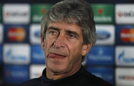 Manchester City's manager Manuel Pellegrini listens to questions during a news conference at the club's Carrington training complex in Manchester