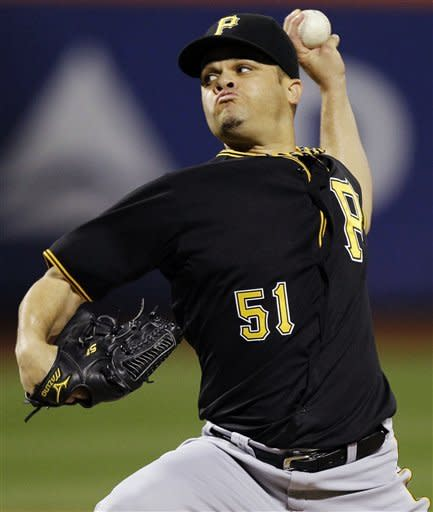 Pittsburgh Pirates starting pitcher Wandy Rodriguez delivers against the New York Mets in the first inning of their baseball game at Citi Field in New York, Tuesday, Sept. 25, 2012. (AP Photo/Kathy Willens)