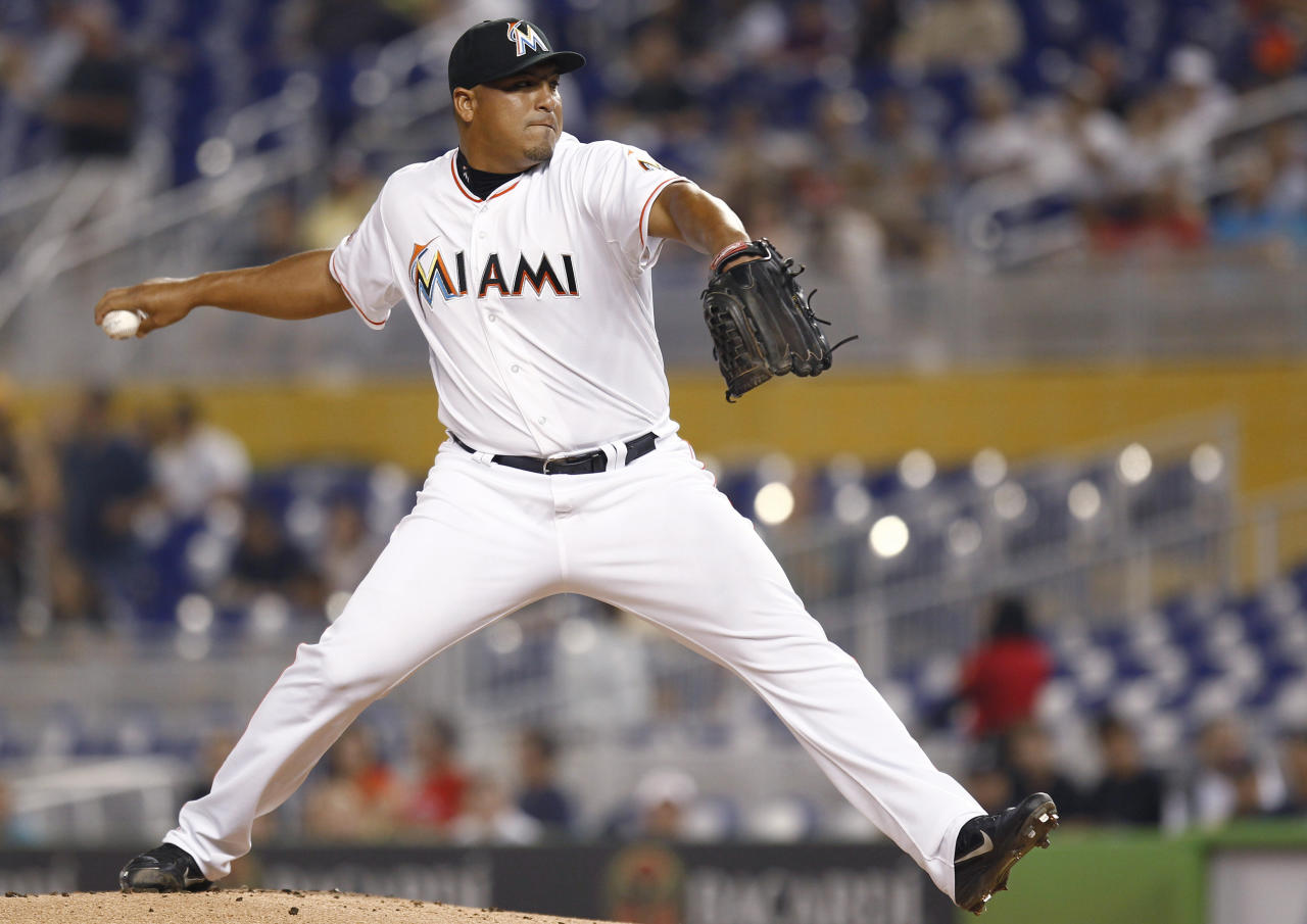 Miami Marlins starter Carlos Zambrano throws to the St. Louis Cardinals during the first inning of a baseball game in Miami, Tuesday, June 26, 2012. (AP Photo/J Pat Carter)