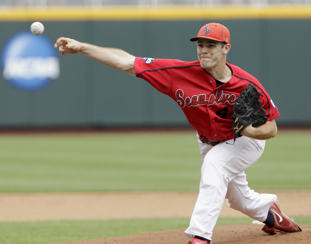 Stony Brook's starting pitcher Tyler Johnson delivers against UCLA in the first inning of an NCAA College World Series baseball game in Omaha, Neb., Friday, June 15, 2012. (AP Photo/Nati Harnik)