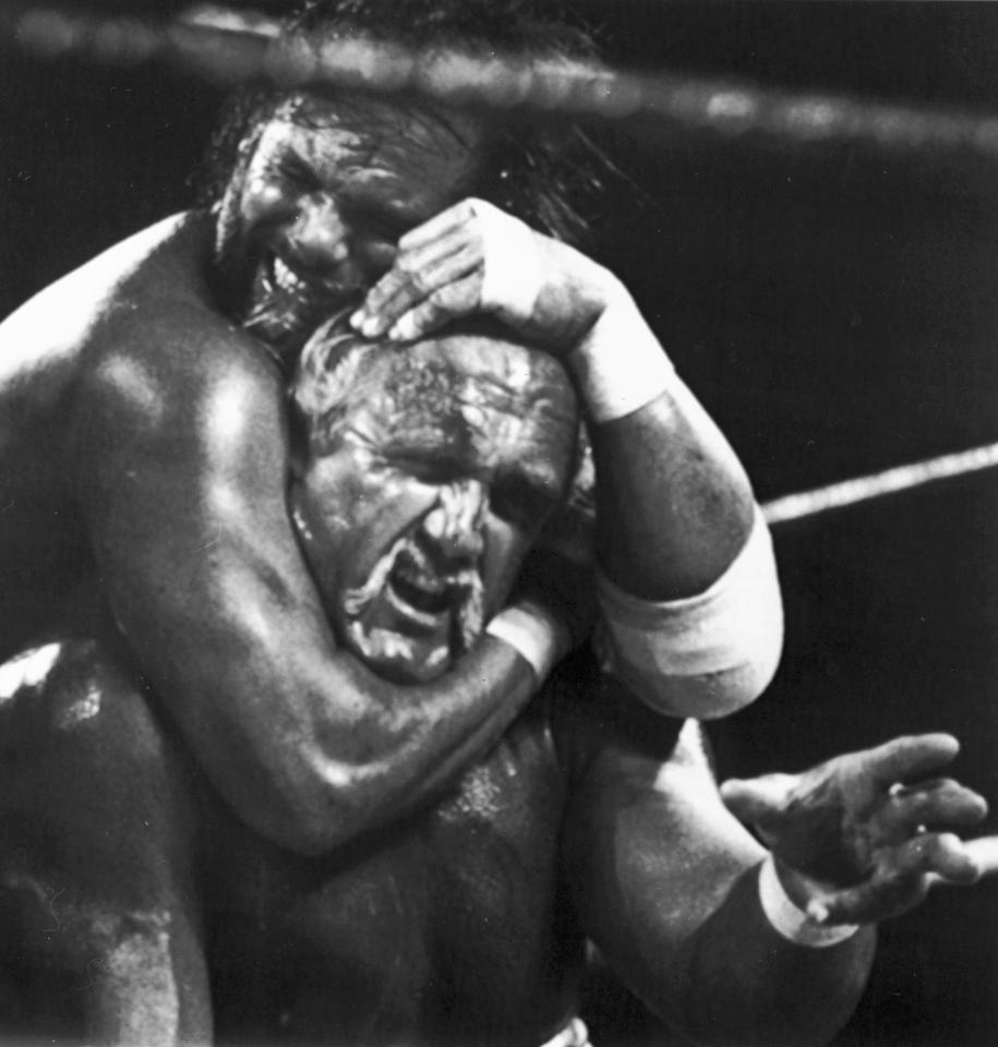 """FILE - In this April 4, 1989 file photo, Randy """"Macho Man"""" Savage, top, has challenger Hulk Hogan in a headlock during the main event for Wresltemania V in Atlantic City, N.J. Savage, whose legal name is Randy Mario Poffo, died in a car crash in Florida on Friday, May 20, 2011, according to a Florida Highway Patrol crash report."""