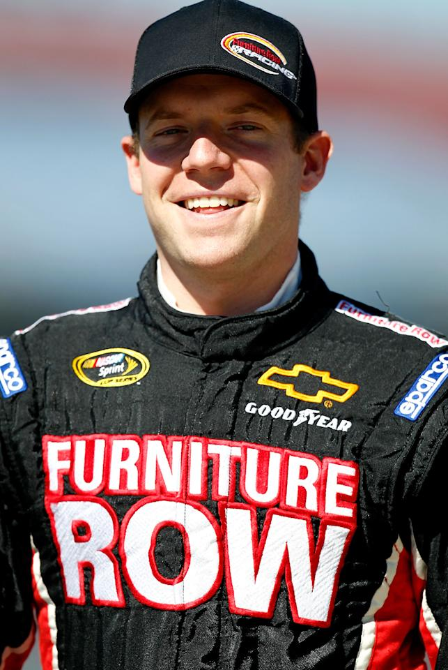 TALLADEGA, AL - OCTOBER 22:  Regan Smith, driver of the #78 Furniture Row Companies Chevrolet, walks on pit road during qualifying for the NASCAR Sprint Cup Series Good Sam Club 500 at Talladega Superspeedway on October 22, 2011 in Talladega, Alabama.  (Photo by Jeff Zelevansky/Getty Images for NASCAR)