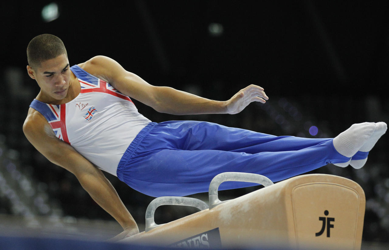 Louis Smith of Britain performs on the pommel horse during the men's qualifying session for the World Gymnastics Championships in Rotterdam, Netherlands, Monday Oct. 18, 2010.