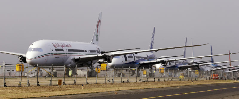 Some road warriors standing by Boeing's 787