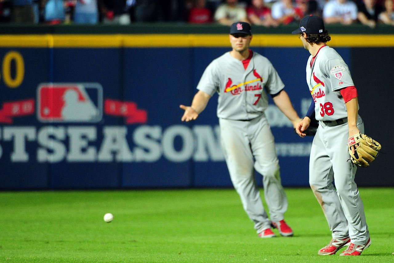 ATLANTA, GA - OCTOBER 05:  Matt Holliday #7 and Pete Kozma #38 of the St. Louis Cardinals react after the ball hits the grass as the infield fly rule is called in the eighth inning on a ball hit by Andrelton Simmons #19 of the Atlanta Braves during the National League Wild Card playoff game at Turner Field on October 5, 2012 in Atlanta, Georgia.  (Photo by Scott Cunningham/Getty Images)