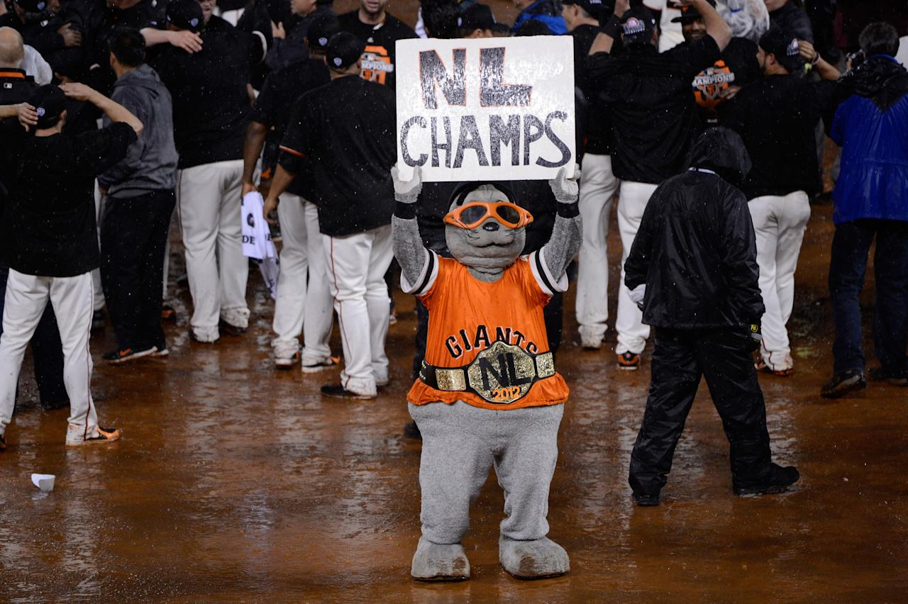 SAN FRANCISCO, CA - OCTOBER 22:  Lou Seal holds up a sign reading 'NL Champs' after the Giants defeat the St. Louis Cardinals 9-0 in Game Seven of the National League Championship Series at AT&T Park on October 22, 2012 in San Francisco, California.  (Photo by Thearon W. Henderson/Getty Images)