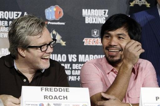 Manny Pacquiao, of the Philippines, right, and his trainer Freddie Roach laugh at a news conference to promote his upcoming boxing match against Juan Manuel Marquez in Beverly Hills, Calif., Monday, Sept. 17, 2012. The two will fight for the fourth time on Dec. 8 in Las Vegas. (AP Photo/Reed Saxon)
