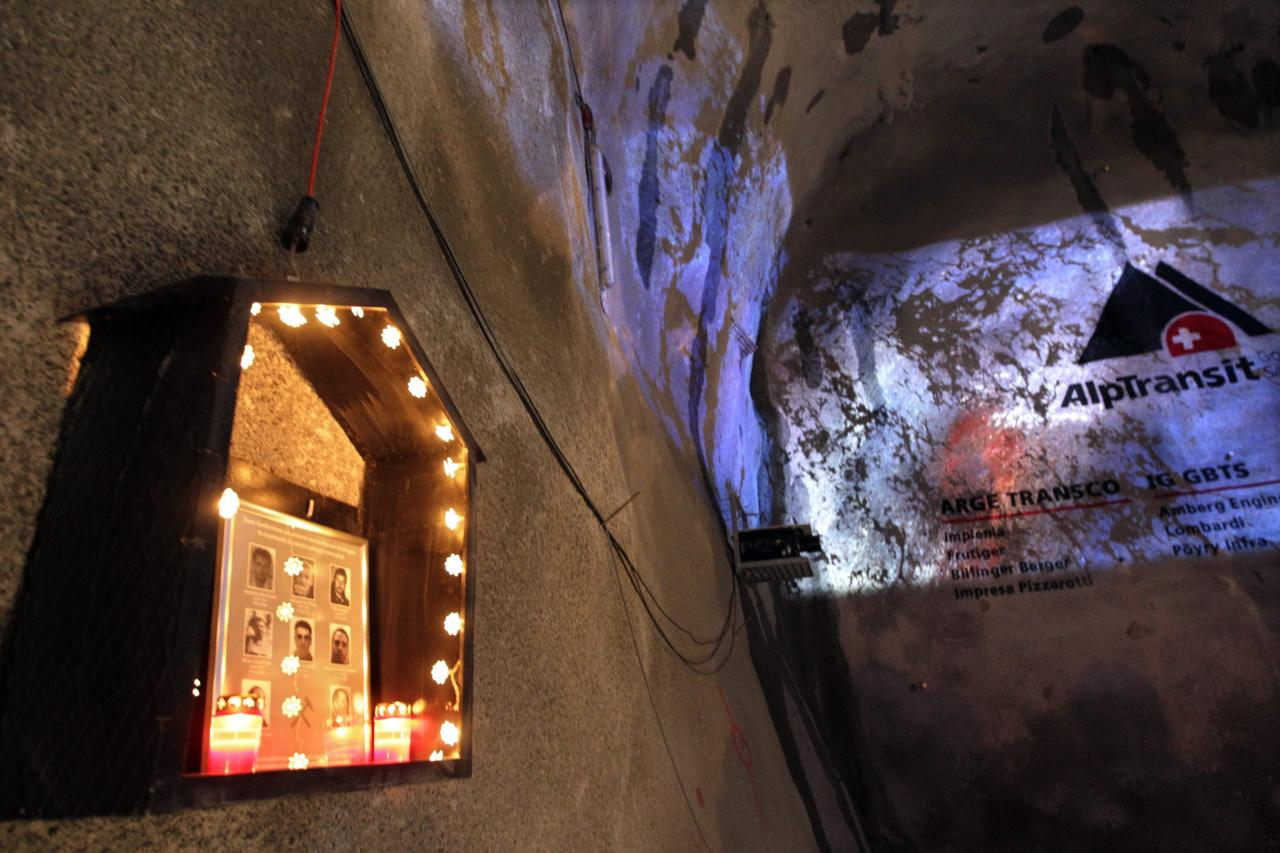 A small chapel in memory of the eight miners killed during the construction of the tunnel hangs at a wall of the Gotthard Base Tunnel near Sedrun in the canton of Grisons, Switzerland, Oct. 15, 2010. With 57 kilometers (35-miles) the new St. Gotthard tunnel is the world's longest tunnel. The 13.157 billion Swiss franc (9.6 billion euros, 13.6 billion US dollars) Alptransit project, which is due to be operational in 2017, constitutes the center piece of the New Railway Link through the Alps. Engineers are expected to start up the massive drilling machine - nicknamed Sissi - at 2 p.m. (1200 GMT; 8 a.m. EDT) so it can chew through the last remaining rock separating the two ends of the 57-kilometer (35.4-mile) Gotthard Base Tunnel.