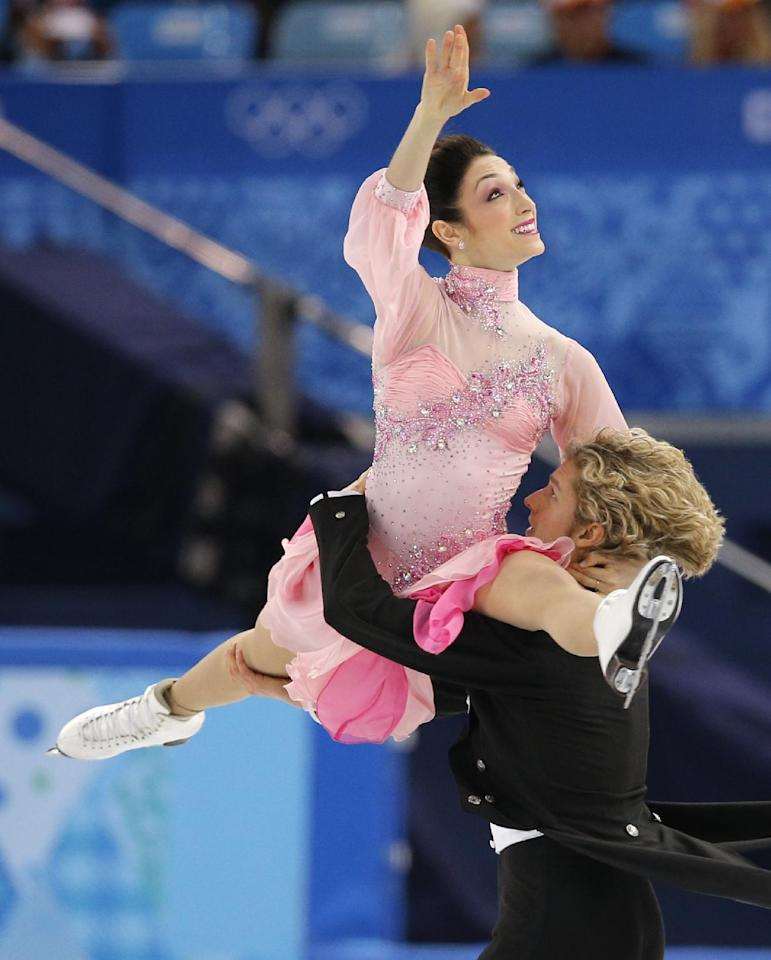 Meryl Davis and Charlie White of the United States compete in the ice dance short dance figure skating competition at the Iceberg Skating Palace during the 2014 Winter Olympics, Sunday, Feb. 16, 2014, in Sochi, Russia. (AP Photo/Vadim Ghirda)