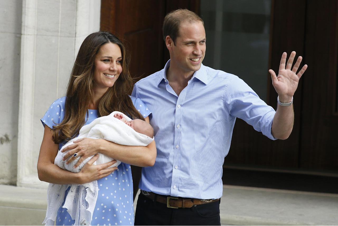 FILE - In this July 23, 2013 photo, Britain's Prince William, right, and Kate, Duchess of Cambridge, hold the Prince of Cambridge, as they pose for photographers outside St. Mary's Hospital exclusive Lindo Wing in London where the Duchess gave birth on July 22. Britain's Prince William has described his joy at introducing newborn son to the world on the steps of a London hospital last month and about his nerves about fitting the car seat securely into the Land Rover before driving off. (AP Photo/Kirsty Wigglesworth, File)