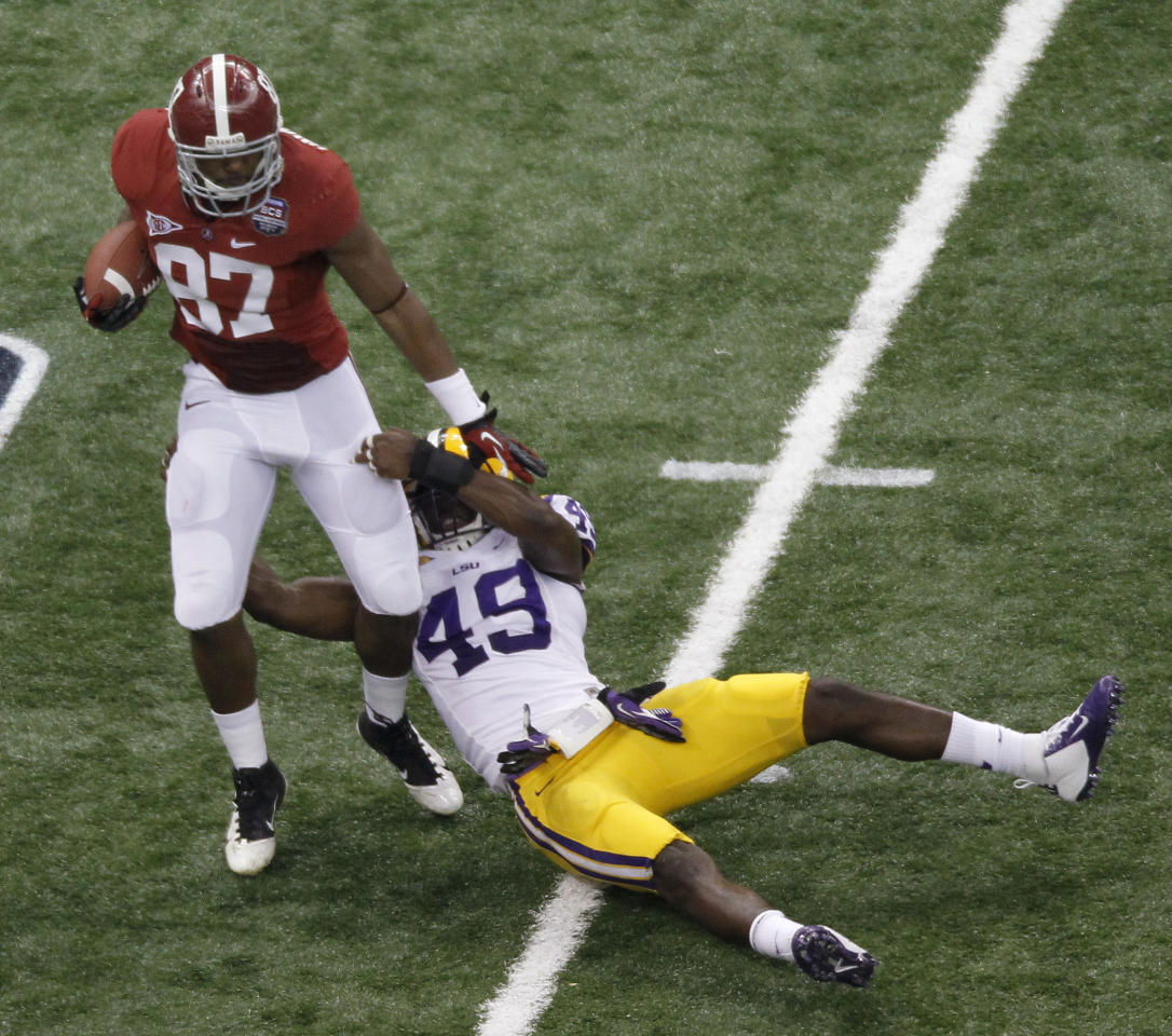 Alabama's Chris Underwood (87) tries to get past LSU's Barkevious Mingo (49) on a fake punt during the first half of the BCS National Championship college football game Monday, Jan. 9, 2012, in New Orleans. Alabama got the first down on the play. (AP Photo/Bill Haber)