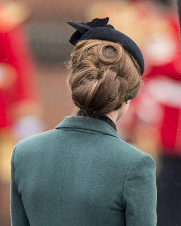 ALDERSHOT, ENGLAND - MARCH 17:  Catherine, Duchess of Cambridge attends The Irish Guards St Patricks Day Parade, at Mons Barracks, where The Duchess presented the traditional sprigs of shamrock, on March 17, 2013 in Aldershot, England.   (Photo by Mark Cuthbert/UK Press via Getty Images)