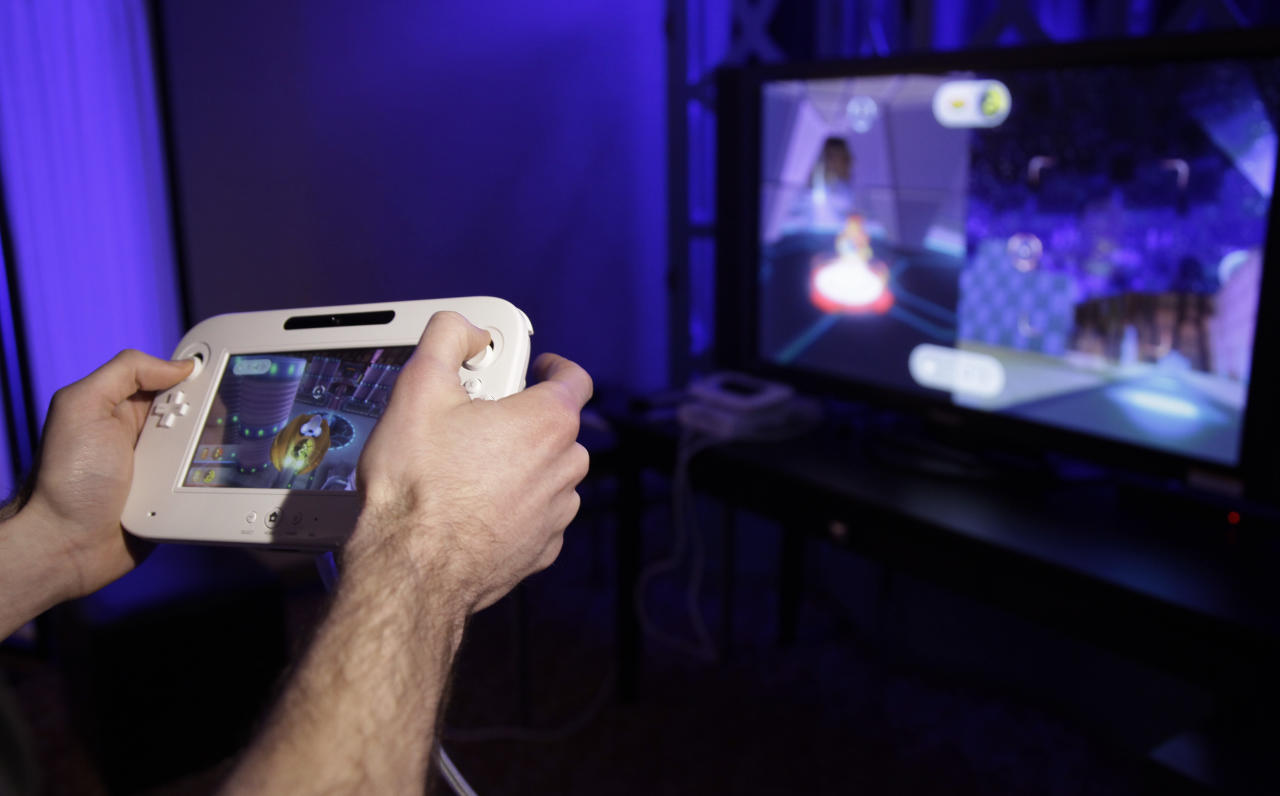 <p>               The new WiiU console is seen during a demonstration at the 2012 International CES tradeshow, Tuesday, Jan. 10, 2012, in Las Vegas.  (AP Photo/Julie Jacobson)