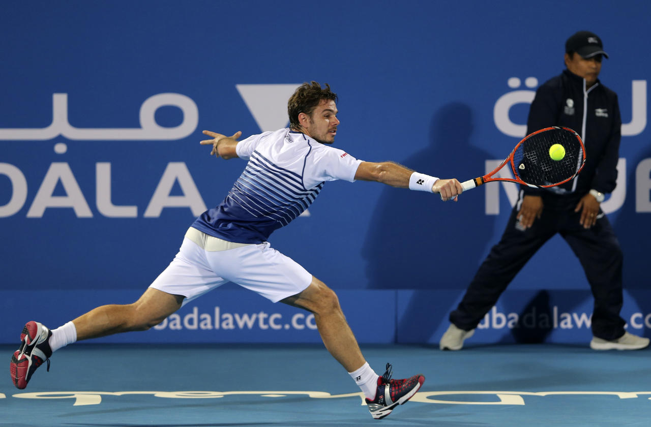 Stanislas Wawrinka of Switzerland returns the ball to Spain's Rafael Nadal during third day of the Mubadala World Tennis Championship in Abu Dhabi, United Arab Emirates, Saturday, Jan. 3, 2015. (AP Photo/Kamran Jebreili)
