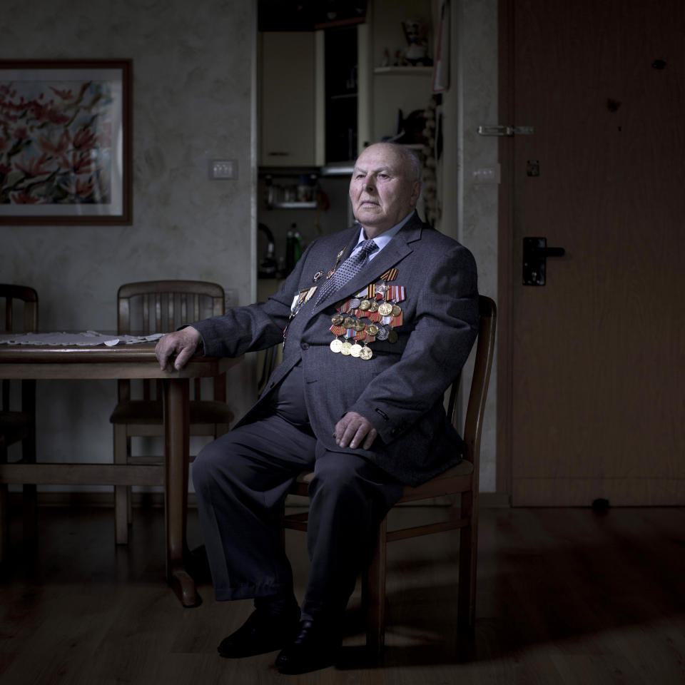 In this photo made Thursday, April 11, 2013, Soviet Jewish World War Two veteran Gregory Stinman, 87, poses for a portrait at his house in the southern Israeli city of Ashdod. Stinman joined the Red Army in 1943 and served in the First Belorussian Front, a Soviet formation equivalent to an Army group, until he was wounded on January 23, 1945. Stinman demobilized in 1950 and immigrated to Israel in 1991 from Belorussia. About 500,000 Soviet Jews served in the Red Army during World War Two, and the majority of those still alive today live in Israel.(AP Photo/Oded Balilty)