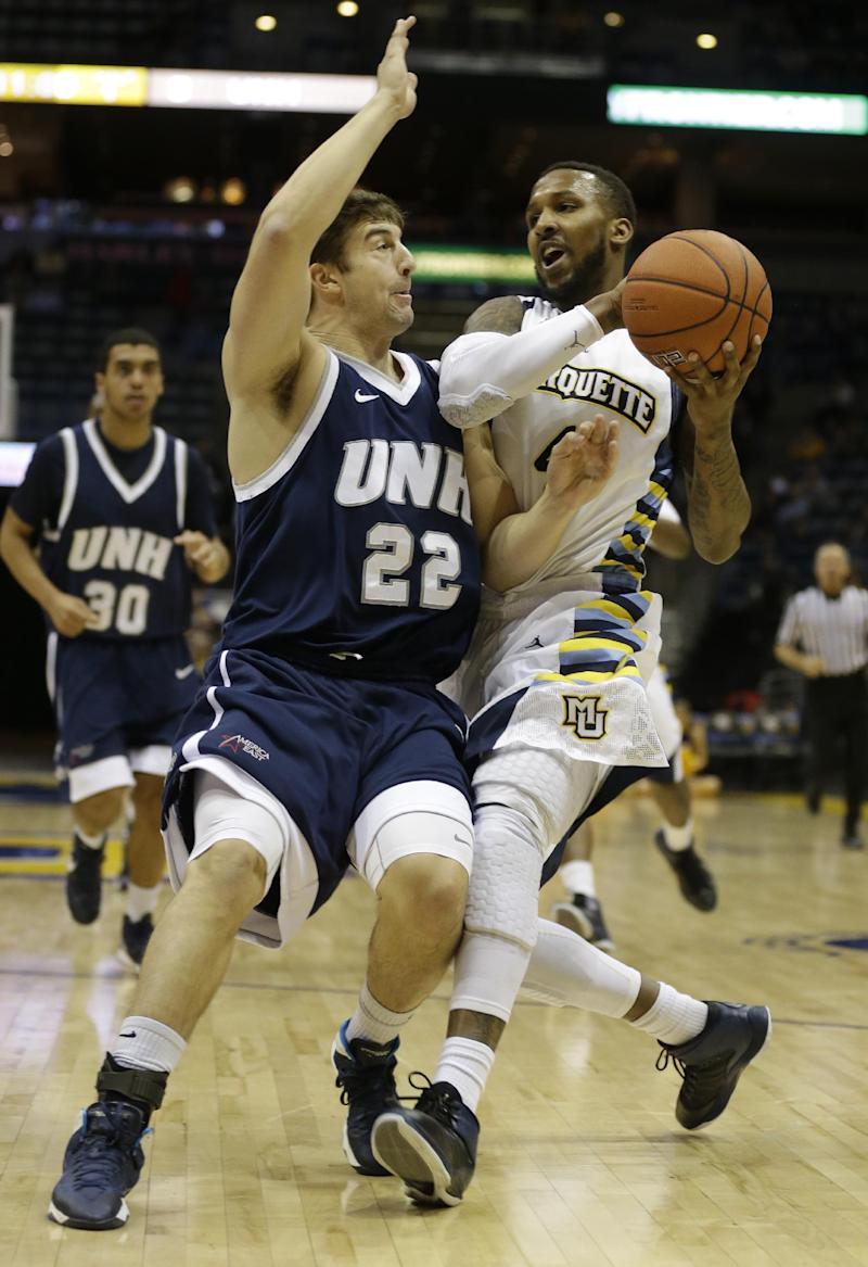No. 25 Marquette holds off New Hampshire 58-53