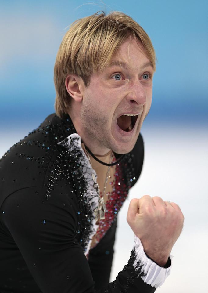 Evgeny Plyushchenko of Russia celebrates after competing in the men's team short program figure skating competition at the Iceberg Skating Palace during the 2014 Winter Olympics, Thursday, Feb. 6, 2014, in Sochi, Russia. (AP Photo/Ivan Sekretarev)