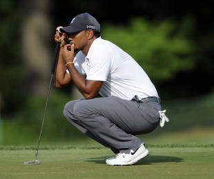 Tiger Woods missed the cut at the Quicken Loans National. (AP)