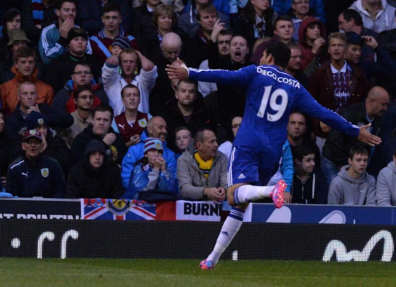 Chelsea's Brazilian-born Spanish striker Diego Costa celebrates scoring a goal in front of the Burnley fans during the English Premier League football match between Burnley and Chelsea at Turf Moor in Burnley, north west England on August 18, 2014
