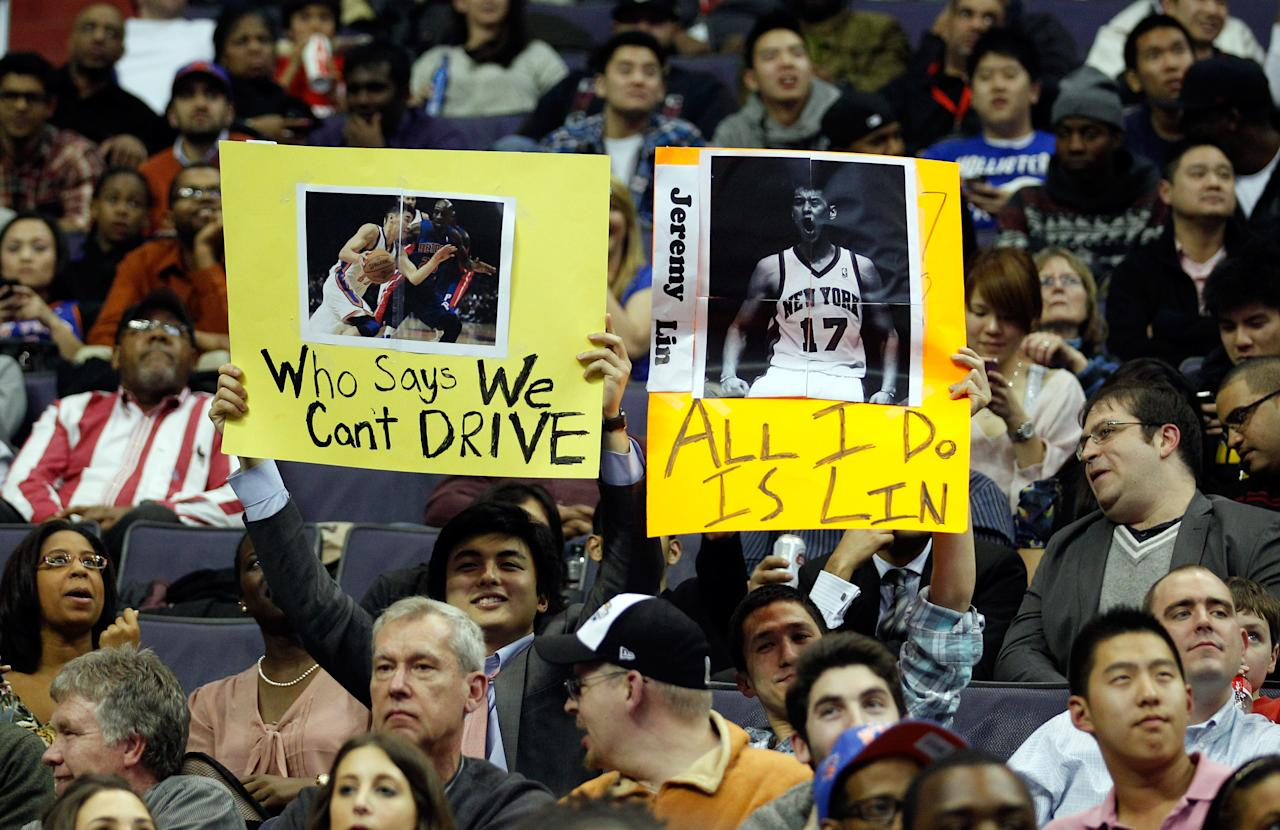 WASHINGTON, DC - FEBRUARY 08:  Fans of Jeremy Lin #17 of the New York Knicks hold up signs during the second half of the Knicks and Washington Wizards game at Verizon Center on February 8, 2012 in Washington, DC. (Photo by Rob Carr/Getty Images)