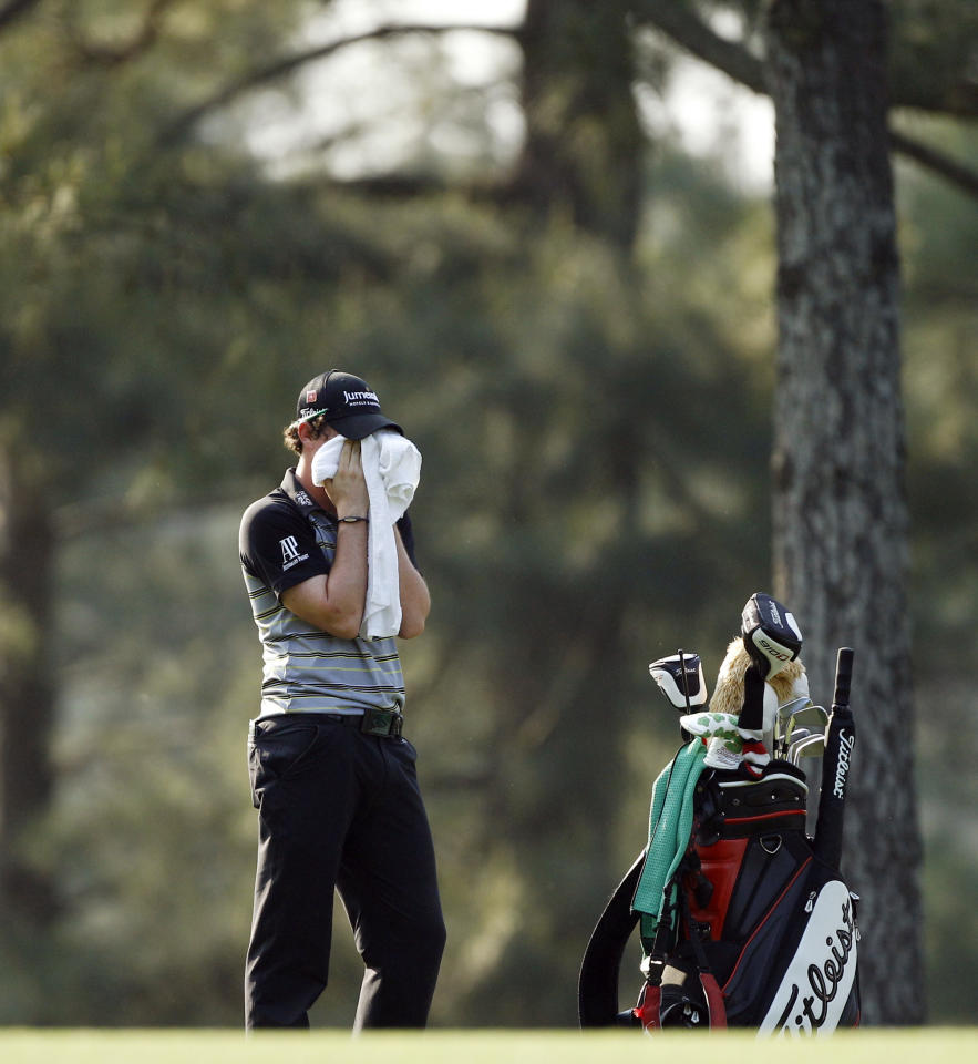 Rory McIlroy of Northern Ireland wipes his face during the final round of the Masters golf tournament Sunday, April 10, 2011, in Augusta, Ga.