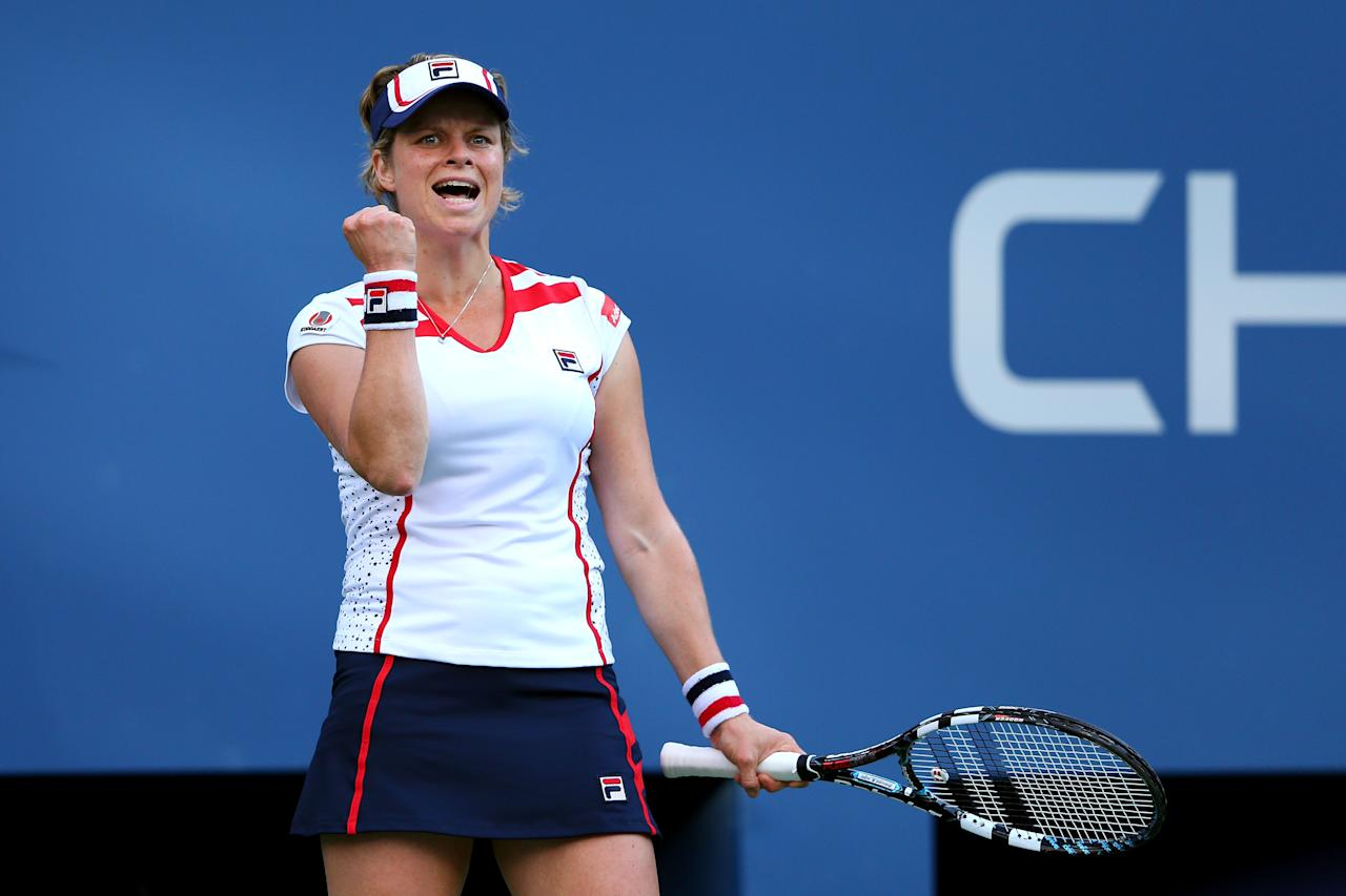 NEW YORK, NY - AUGUST 29:  Kim Clijsters of Belgium celebrates a point against Laura Robson of Great Britain during their women's singles second round match Day Three of the 2012 US Open at USTA Billie Jean King National Tennis Center on August 29, 2012 in the Flushing neigborhood of the Queens borough of New York City.  (Photo by Cameron Spencer/Getty Images)